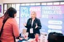 Pink Elephant stand staff networking with delegates