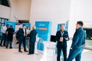 Speakers and delegates networking at the UIPath display