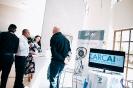 Delegates networking at the Larcai display