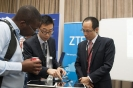 ZTE Staff do a demonstration for one of the delegates at their Exhibition Stand
