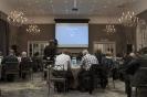 Conference room during Craig Holmes' presentation