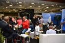 Delegates networking in the exhibition area