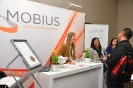 Delegates networking at the Mobius Consulting stand