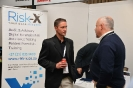 Delegates networking at the Risk X stand