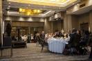 Delegates during presentation in conference room