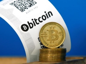 Regulators move closer to regulating fintech, which houses the blockchain technology that supports Bitcoin.